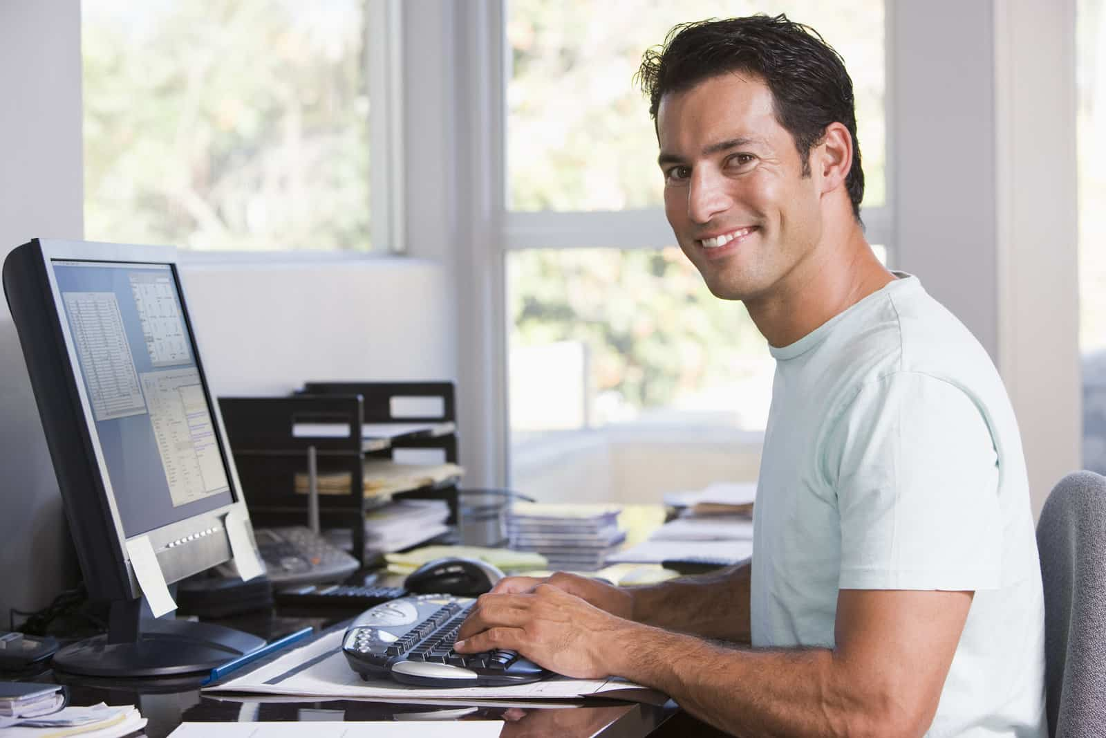 537497 man in home office using computer and smiling