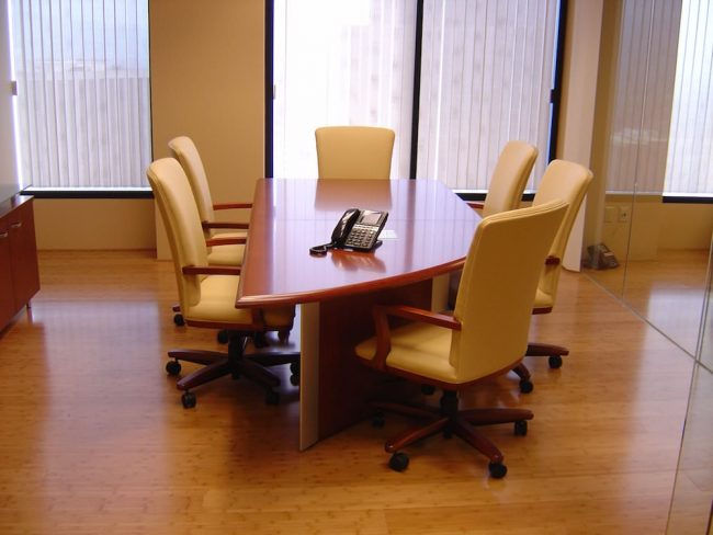 Krug Conference Table with chairs around it